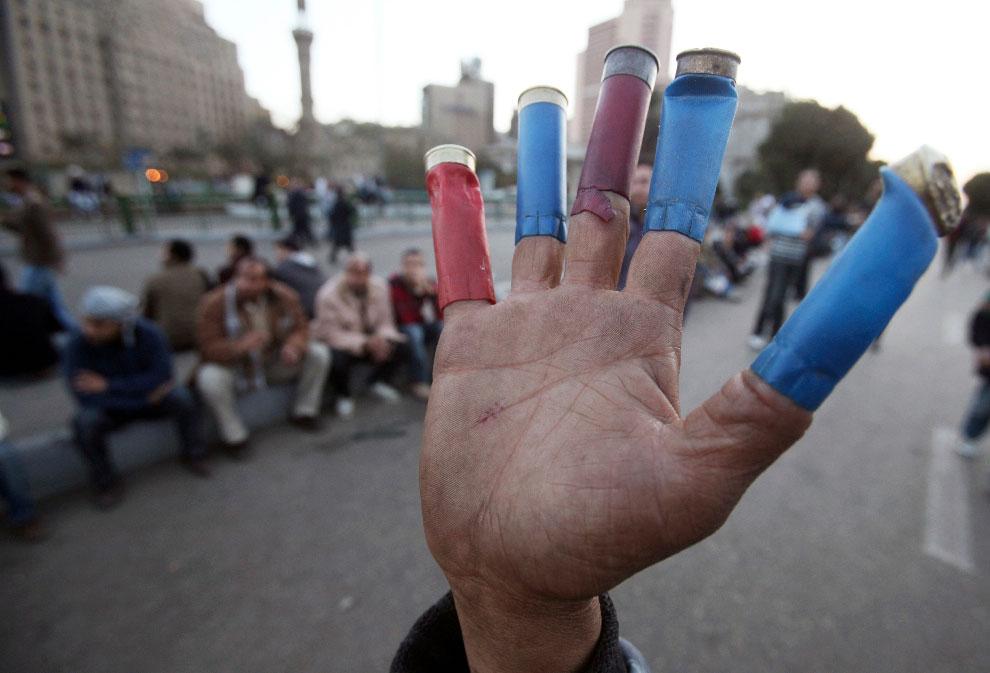 Egypt-Shotgun-Hulls-On-Fingers