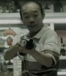 Asian-Man-With-Shotgun
