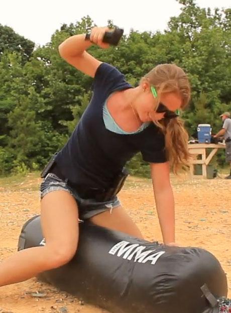 Cory-And-Erica-Punching-Bag-Glock-Beating