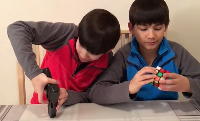 Handgun-Versus-Rubiks-Cube-Solve
